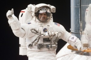 Astronaut Steve Smith Giving A Thumbs Up On The Hubble Space Telescope