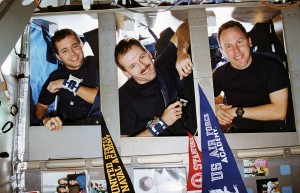 Astronauts Dan Bursch, Steve Smith, and Tom Jones about to sleep on Space Shuttle Endeavour
