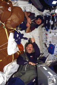 Astronaut Steve Smith Sleeping In Space On A Wall