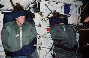 Astronauts Sleeping In Space Strapped Down To The Wall