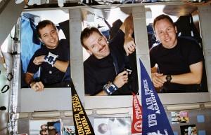 Astronauts Dan Bursch, Steve Smith, and Tom Jones about to sleep on Space Shuttle Endeavour